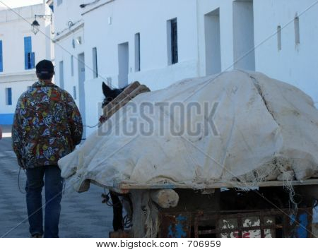A Farm Worker With His Donkey And Cart.