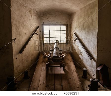 Old cannon in castle interior