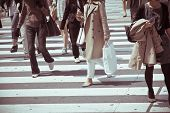 stock photo of zebra crossing  - Pedestrians cross at Shibuya Crossing in tokyo - JPG