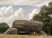 stock photo of megaliths  - Low point of view looking into the opening of these megaliths - JPG