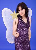 picture of tinkerbell  - young beautiful woman dressed as tinkerbell studio picture - JPG