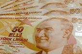 stock photo of lira  - Turkish fifty Lira banknotes laid out in a fan with the face of Mustafa Kemal Ataturk engraved - JPG