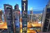 Постер, плакат: The tall towers of Sheikh Zayed Road showcase much of Dubai