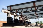 foto of girder  - Steel girders at the road construction in Russia - JPG