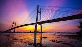 picture of steamy  - Sunset on Phu My bridge at the Saigon river in Ho chi minh city - JPG