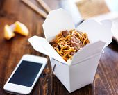 stock photo of chinese menu  - chinese take out with smart phone on table and menu - JPG