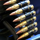 picture of m16  - A close up shot of a row of machine gun bullets with copper tips  - JPG