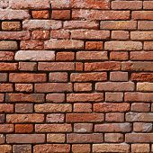 picture of derelict  - Abandoned orange brick wall background with derelict pattern - JPG