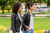 pic of bff  - Two north African teen friends take a walk in the park talking  - JPG