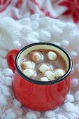 picture of whip-hand  - Hot chocolate with marshmallows in a red mug - JPG