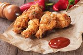 stock photo of southern fried chicken  - Southern fried chicken wings with barbecue sauce - JPG