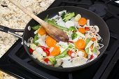 picture of snow peas  - Fresh mixed vegetable stir fry with onions - JPG