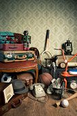 pic of attic  - Assorted vintage items in the attic with retro wallpaper background - JPG