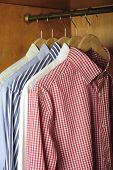 picture of wardrobe  - wardrobe and shirts hanging in a wardrobe - JPG