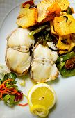 stock photo of hake  - Grilled Hake with potatoes and green peppers - JPG