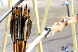 image of bow arrow  - A set of wooden arrows and a re-curved bow ** Note: Soft Focus at 100%, best at smaller sizes - JPG