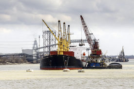 stock photo of coal barge  - Cargo ship loading in the port - JPG