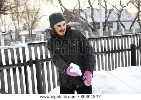 Funny Man Throwing A Snowball