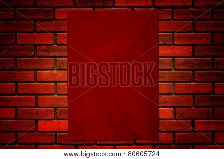 Red Paper On Brick Wall