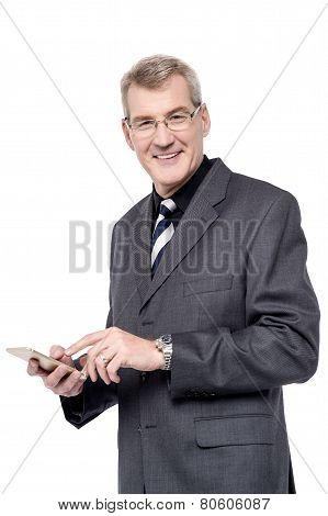 Senior Businessman Using A Cell Phone