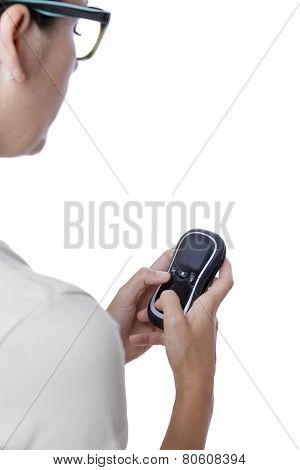 Young Woman Using A Glucometer.