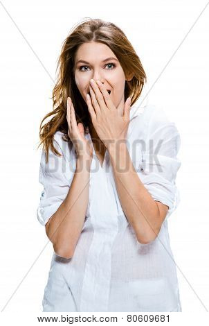 Surprised happy young woman puts her hands over her mouth in excitement