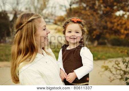 Laughing Mother And Baby Daughter