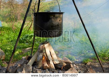 Pot Boiling On The Fire