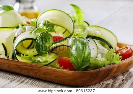 Zucchini salad with tomatoes and feta cheese