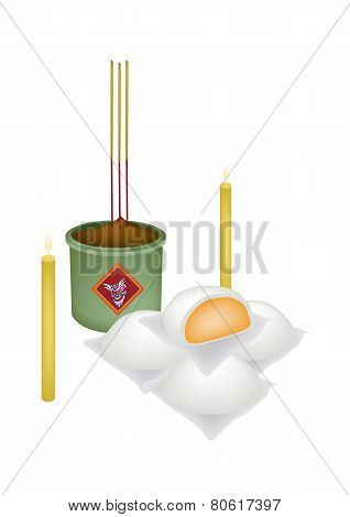 Chinese Steamed Bun with Candle and Joss Stick