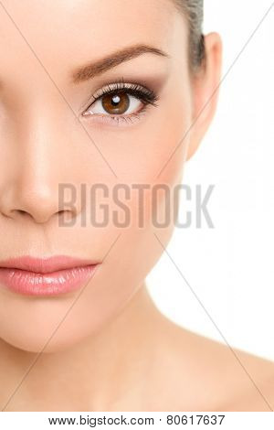 Beauty face closeup - Asian woman eye makeup concept with mascara smokey eyeshadow and eyeliner
