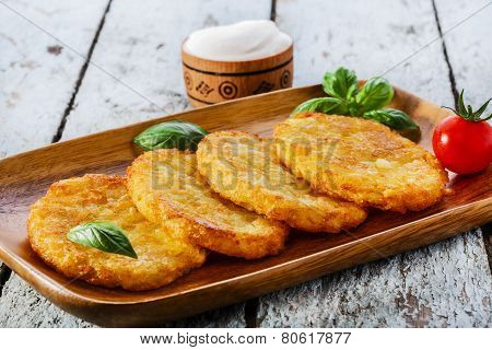 fried potato pancakes on a wooden surface