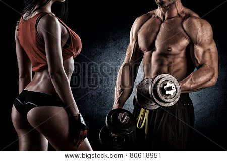 Closeup Of A Muscular Young Man Lifting Weights