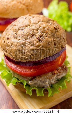 Healthy Chicken Hamburger with a Whole Grain Bun and Vegetables