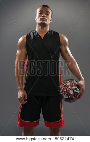 Young handsome African man posing with basketball ball