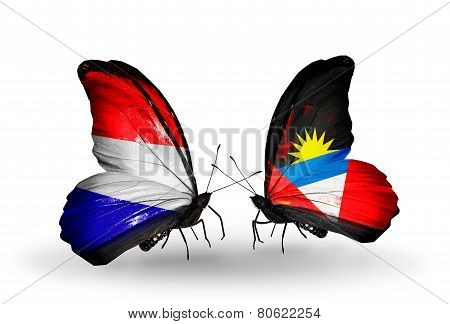 Two Butterflies With Flags On Wings As Symbol Of Relations Holland And Antigua And Barbuda