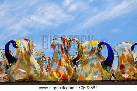 Mexican Glass Jars On Blue Sky Background