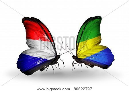 Two Butterflies With Flags On Wings As Symbol Of Relations Holland And Gabon