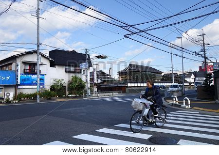 The Lady Is Cycling In The Road In Hiroshima, Japan