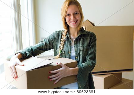 Young Beautiful Woman Moving In A New Home.