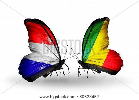 Two Butterflies With Flags On Wings As Symbol Of Relations Holland And Kongo