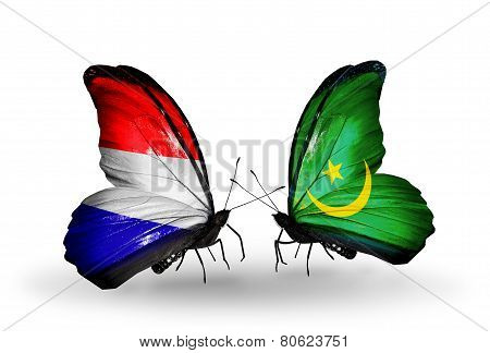 Two Butterflies With Flags On Wings As Symbol Of Relations Holland And Mauritania