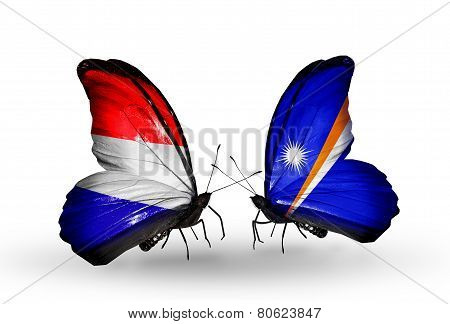 Two Butterflies With Flags On Wings As Symbol Of Relations Holland And Marshall Islands