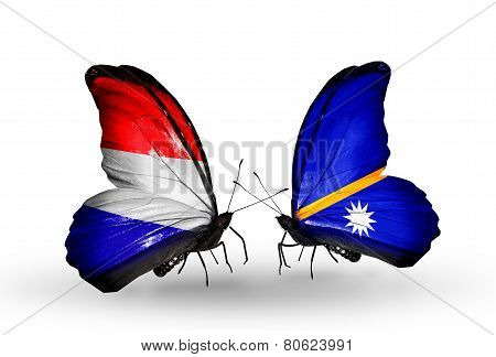Two Butterflies With Flags On Wings As Symbol Of Relations Holland And Nauru