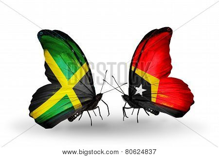 Two Butterflies With Flags On Wings As Symbol Of Relations Jamaica And   East Timor