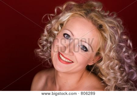 Beautiful woman with curly hair laughing