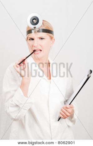 young female doctor with stethoscope and folder with notes