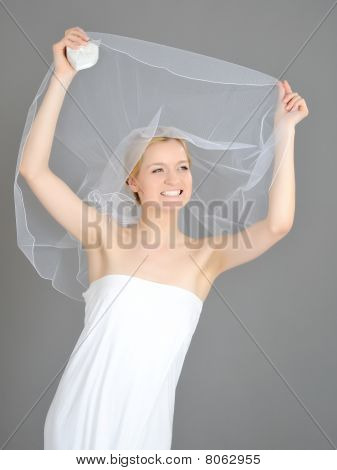 Young Beautiful Bride Covered In Veil