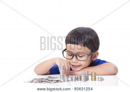 Cute boy stacking coins