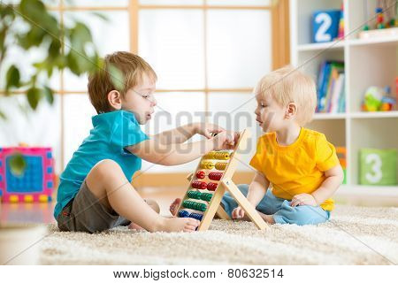children boys playing with abacus